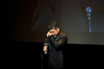 Japanese film director Hirokazu Koreeda reacts after receiving his Donostia Award for Lifetime Achievement at the San Sebastian Film Festival