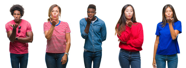 Composition of african american, hispanic and chinese group of people over isolated white background looking at the camera blowing a kiss with hand on air being lovely and sexy. Love expression.