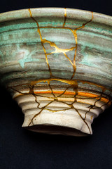This is a bowl that I repaired using the Japanese art form of kintsugi with urushi lacquer and gold powder.