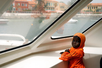 A Senegalese girl looks around as she approaches the island of Goree off the coast of Dakar