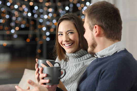 Couple talking in the night in winter at home