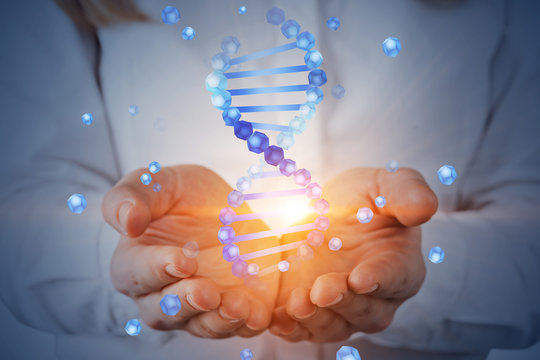 Woman holding dna helix hologram