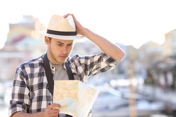 Lost tourist consulting guide in a coast town