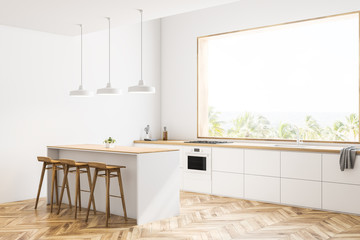 White kitchen corner with bar and stools