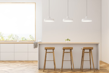 Modern white kitchen with bar and stools, front