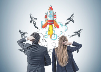 Confused business people looking at startup launch