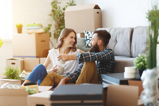 happy young married couple moves to new apartment.