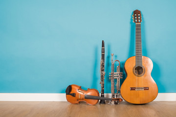 classical guitar, violin, clarinet and trumpet in vintage background