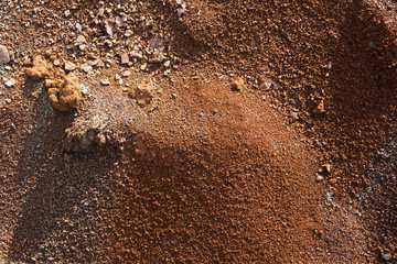 Red earth or soil background. Tropical laterite soil  background of red clay. Dry Orange surface, Picture of natural disaster. Drought land Caused by global warming and deforestation.