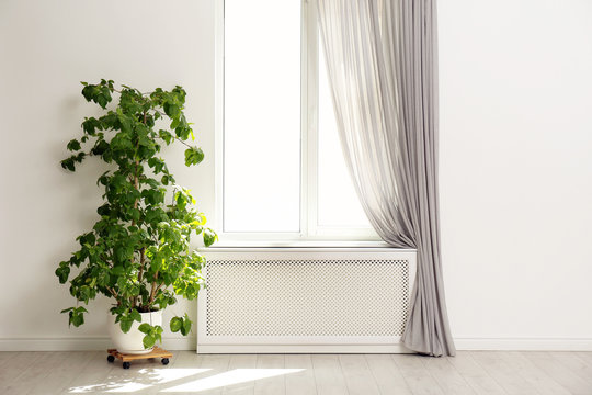Light room with window and open curtains. Home interior
