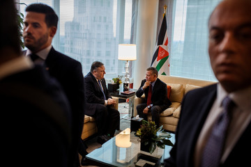 U.S. Secretary of State Mike Pompeo, center left, talks to Jordan's King Abdullah II bin Al-Hussein, center right, during a meeting at Mandarin Oriental Hotel,Êin New York