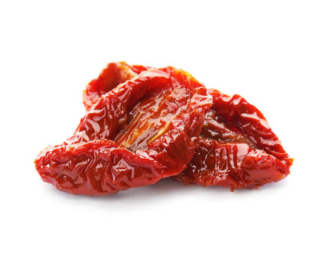 Tasty sun dried tomatoes on white background