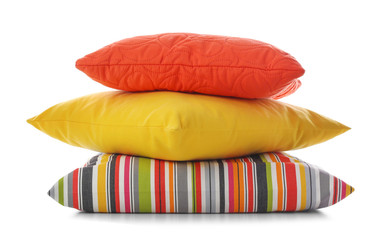 Stack of different colorful pillows on white background