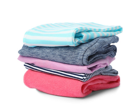 Stack of colorful children's clothes on white background