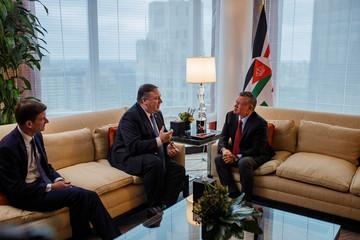 U.S. Secretary of State Mike Pompeo, left, talks to Jordan's King Abdullah II bin Al-Hussein, right, during a meeting at Mandarin Oriental Hotel,Êin New York