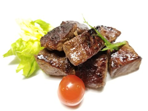 Cubed Filet Mignon with Trimmings on a White Background