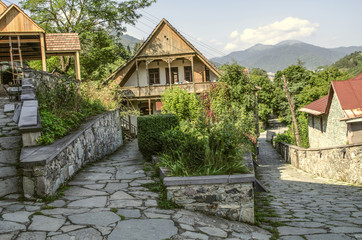 View of the intersecting cobbled streets with old stone houses with wooden balconies and wrought iron bars in the Tufenkian Museum Old Dilijan