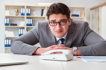 Businessman expecting important call on phone