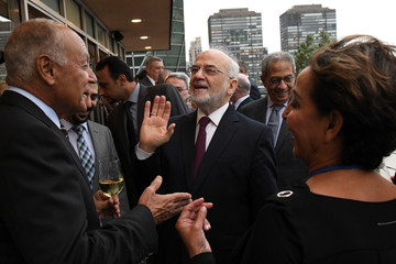 Arab League Secretary General Ahmed Aboul Gheit speaks with Iraqi Foreign Minister Ibrahim al-Jaafari at the International Peace Institute's Annual Ministerial Dinner on the Middle East in New York