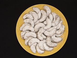 Crescent Cookies with Powdered Sugar OH,Yellow on Black