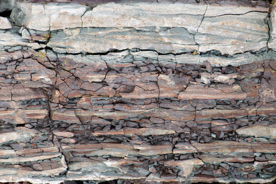 Soil cut-sandstone, stones, clay, sand structure and layers. slice of sand with layers of different structures.