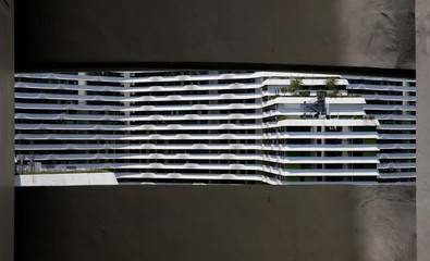 A public housing block is seen through a window in Singapore