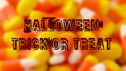 Macro closeup of Halloween traditional Candy Corn treats, blurred background with greetin text.