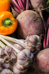Fresh vegetables on wooden background. healthy food