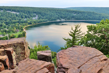 Beautiful Wisconsin nature background. Areal view on the South shore beach and lake from rocky ice age hiking trail. Devils Lake State Park, Baraboo area, Wisconsin, Midwest USA.