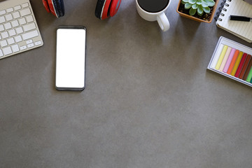 Empty smartphone on workspace with  office supplies and copy space for top view.