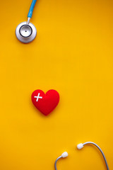 Red heart with stethoscope for background