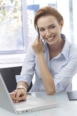 Closeup portrait of happy woman on mobile