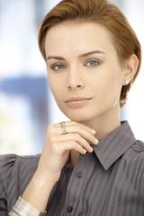 Portrait of thinking businesswoman
