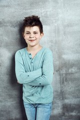 Little boy standing arms crossed