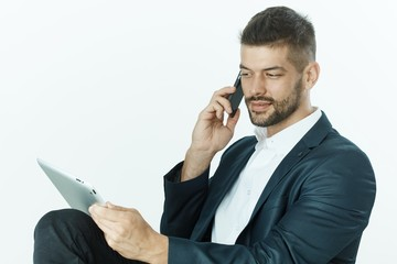 Businessman on the phone using tablet computer