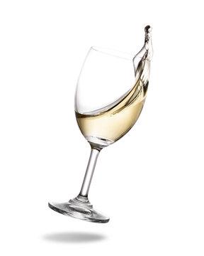 White wine splashing out of glass isolated on white background.