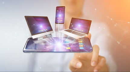 Modern devices connected in businesswoman hand 3D rendering