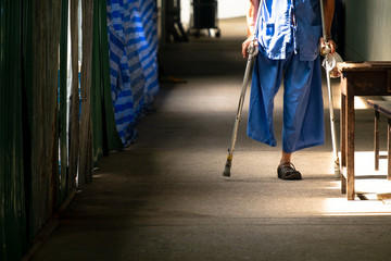 Disabled Old Man Walking in the Small Walk Path in the Hospital