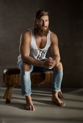 Full length portrait of young bearded man