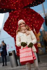 Young happy woman shopping for Christmas