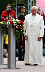 Pope Francis attends a wreath-laying ceremony at the Freedom Monument in Riga