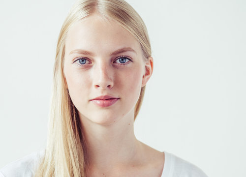 Beautiful blonde woman natural portrait with long blonde smooth hair
