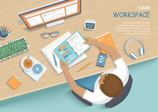 Man sitting at the wooden table. Workplace Desktop Workspace Armchair, office supplies, monitor, books, notebook, headphones, phone, glasses, pen, paper, tea, donuts. Vector Top view