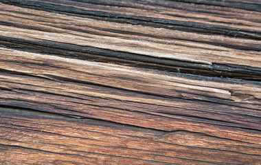 Old timber texture of the log surface of an old traditional wooden house