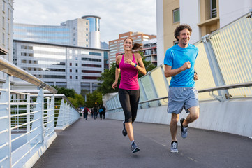 Smiling mature couple jogging