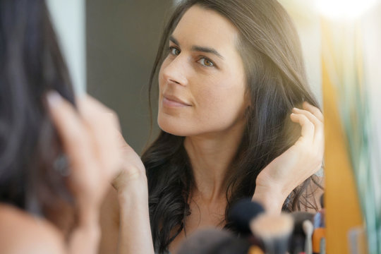 Brunette woman worried about her hair