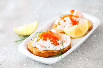 Toast skagen - shrimp and caviar on toast. Classic swedish appetizer. Selective focus. Copy space