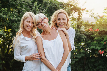 Three women enjoying outdoors, talking and laughing
