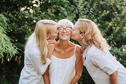 Three women enjoying outdoors, talking and laughing