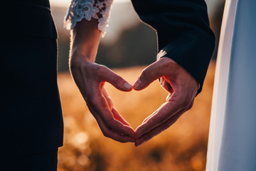 Hands of man and woman in shape of heart, wedding, valentine, love photo